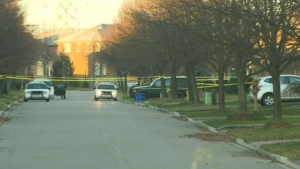 Police tape blocks off the scene where a woman was found lifeless in Markham on Friday, Nov. 28, 2014.