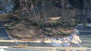 Mudslide topples trees, mud onto Highway 403