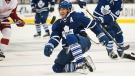Toronto Maple Leafs' Joffrey Lupul recovers from a check against the Detroit Red Wings during second period pre-season NHL action in Toronto on Friday, Oct. 3, 2014. (Aaron Vincent Elkaim / THE CANADIAN PRESS)