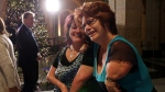Thalidomide survivors Arlene Vachon, left and Myriam Bouffard celebrate outside the House of Commons on Parliament Hill, after the House of Commons voted to compensate survivors of thalidomide, in Ottawa on Monday, Dec. 1, 2014. (Fred Chartrand / THE CANADIAN PRESS)