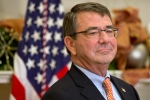 Ashton Carter listens in the Roosevelt Room of the White House in Washington, Friday, Dec. 5, 2014. (AP Photo/Jacquelyn Martin)
