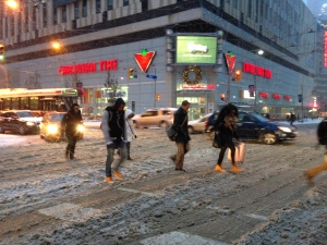 Pedestrians walk in the snow at Bay and Dundas streets in Toronto, Thursday, Dec. 11, 2014. (George Stamou / CTV News)