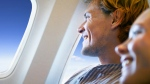 Airlines passengers look out the window in this file photo. (Yuri Arcurs/shutterstock.com)