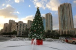 In this Saturday, Dec. 21, 2013 file photo, a large Christmas tree with fake snow around it, is showcased on a street in Dubai, United Arab Emirates. (AP Photo/Kamran Jebreili, File)