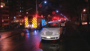 Toronto Fire Services vehicles can be seen outside a highrise residential building on Dunn Avenue, in Parkdale, on Wednesday, Dec. 17, 2014.