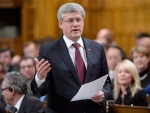 Prime Minister Stephen Harper speaks during Question Period in the House of Commons on Parliament Hill in Ottawa, Tuesday Dec.2, 2014. (Adrian Wyld / THE CANADIAN PRESS)