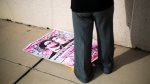 A poster for the movie 'The Interview' lays on the ground after being pulled from a display case by a worker at a Carmike Cinemas movie theater, Wednesday, Dec. 17, 2014, in Atlanta. (AP/David Goldman)