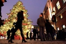 Shoppers take in the sights at the Toronto Christmas Market in The Distillery Historic District on Thursday Dec. 18, 2014. (Frank Gunn / THE CANADIAN PRESS)
