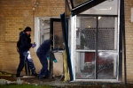 Police investigate a building after the entrance was blown up early Saturday morning Dec. 20, 2014 in Malmo Sweden. (AP / TT News Agency, Stig-Ake Jonsson)