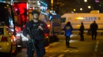 Police guard the scene where two NYPD officers were shot in New York on Saturday, Dec. 20, 2014. (AP / John Minchillo)