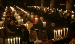 Pakistani Christians attend a prayer service for the victims killed in Tuesday's Taliban attack on a military-run school in Peshawar on Sunday, Dec. 21, 2014 at Sacred Heart Cathedral in Lahore, Pakistan. (AP / K.M. Chaudary)