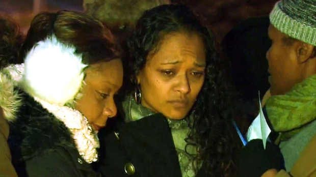 Crystal Diljohn attends a candlelight vigil for her daughter Amaria, on Sunday, Dec. 21, 2014.