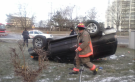 An SUV rolled over into a backyard near Dixon Road and Highway 401 in Toronto, on Dec. 20, 2014. (Tina Biasutti)