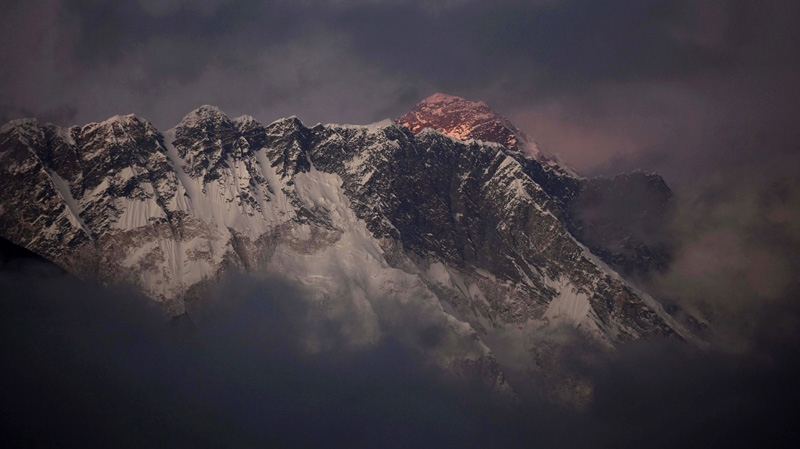 In this Oct. 27, 2011 file photo, the last light of the day sets on Mount Everest as it rises behind Mount Nuptse as seen from Tengboche, in the Himalaya's Khumbu region, Nepal.
