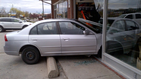 A silver vehicle hit a vacuum store in Richmond Hill on April 22, 2012.