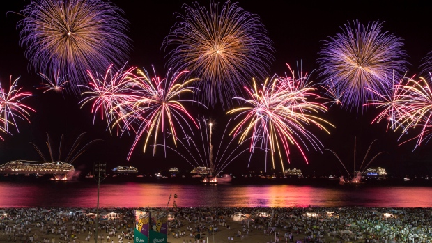 As the clock strikes midnight, fireworks explode in celebration to welcome in the New Year.<br><br>People watch fireworks exploding over Copacabana beach during New Year celebrations in Rio de Janeiro, Brazil, Thursday, Jan. 1, 2015. (AP / Felipe Dana)