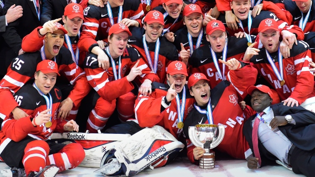 Members of Team Canada gather for a team photo following their gold medal victory over Team Russia at the IIHF World Junior Championship in Toronto on Monday, Jan. 5, 2015. (Frank Gunn / THE CANADIAN PRESS)