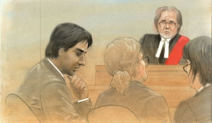 Jian Ghomeshi listens to a judge in a Toronto courtroom in this court sketch from Thursday, Jan. 8, 2015. (John Mantha / CTV News)