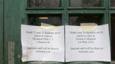 A note on the door of Danforth Collegiate and Technical Institute on Monday, April 30, 2012, tells students where to go while the school is closed.
