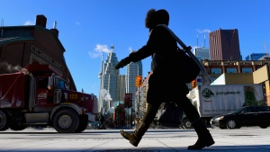 A woman walks in downtown Toronto on Jan. 7, 2015.