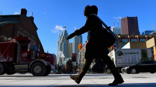 A woman walks in downtown Toronto on Jan. 7, 2015.