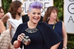Kelly Osbourne arrives at the 72nd annual Golden Globe Awards at the Beverly Hilton Hotel in Beverly Hills, Calif on Sunday, Jan. 11, 2015. (Invision / John Shearer)