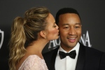 Chrissy Teigen, left, and John Legend arrive at the 16th annual InStyle and Warner Bros. Golden Globes afterparty at the Beverly Hilton Hotel in Beverly Hills, Calif. on Sunday, Jan. 11, 2015. (Matt Sayles / Invision)