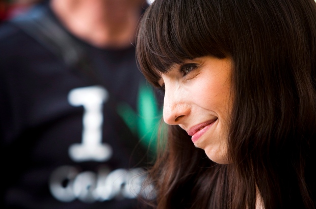 Jodie Emery, wife of Marijuana activist Marc Emery listens to her husband during his 'welcome home party' in downtown Vancouver, B.C., on Sunday, August 17, 2014. THE CANADIAN PRESS/Ben Nelms