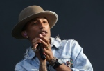 In this July 4, 2014 file photo, Pharrell Williams performs on the main stage at Wireless festival in Finsbury Park, north London. (Photo by Joel Ryan / Invision / AP Photo)