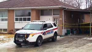 Police investigate at a home on Longford Drive in Newmarket, Ont., on Saturday, Jan. 24, 2015.