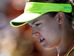Eugenie Bouchard of Canada rests during a break in her fourth round match against Irina-Camelia Begu of Romania at the Australian Open tennis championship in Melbourne, Australia, Sunday, Jan. 25, 2015. (Vincent Thian / AP Photo)