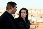 Special Envoy of the United Nations High Commissioner for Refugees (UNHCR), Angelina Jolie speaks with Dohuk governor, Farhad Atrushi, during a press conference in Khanke camp in Dahuk, north of the Kurdistan region, 430 kilometers northwest of Baghdad, Iraq on Jan. 25, 2015. (Seivan M. Selim / AP Photo)