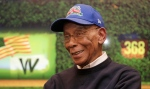 In this March 24, 2014, file photo Chicago Cubs' Hall of Fame slugger Ernie Banks talks during an interview at the Cubs offices in Chicago. (M. Spencer Green / AP Photo)