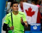 Milos Raonic of Canada celebrates after defeating Feliciano Lopez of Spain in their fourth-round match at the Australian Open tennis championship in Melbourne, Australia, Monday, Jan. 26, 2015. (AP / Vincent Thian)