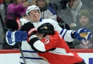Ottawa Senators' Milan Michalek hits Toronto Maple Leafs' Dion Phaneuf during first period NHL hockey action in Ottawa on Wednesday, Jan 21, 2015. (Sean Kilpatrick/THE CANADIAN PRESS)