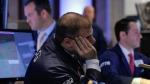 Specialists work on the floor of the New York Stock Exchange Tuesday, Jan. 27, 2015. U.S. stocks fell, dragging Asian stock markets down as well. (AP / Richard Drew)