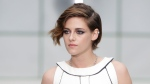 Actress Kristen Stewart poses for photographers as she arrives for Chanel 's Spring-Summer 2015 Haute Couture fashion collection, presented in Paris, France, Tuesday, Jan. 27, 2015. (AP / Thibault Camus)