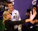 New England Patriots' Rob Gronkowski poses for a selfie with Charissa Thompson during media day for NFL Super Bowl XLIX football game Tuesday, Jan. 27, 2015, in Phoenix. (AP / David J. Phillip)