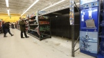 With a run on bottled water earlier in the day late night shoppers were were greeted with empty shelves after Winnipeg authorities issued a boil water advisory after an E.coli positive test, Tuesday, Jan. 27, 2015. (John Woods /  THE CANADIAN PRESS)
