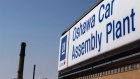 In this Monday, Sept. 17, 2012, file photo, a sign stands outside Oshawa's General Motors car assembly plant in Oshawa, Canada. (Michelle Siu / The Canadian Press)