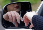 A woman is shown smoking a cigarette while sitting in her truck in Hayneville, Ala., on March 2, 2013. (AP / Dave Martin)