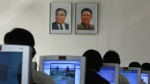 In this Thu., Sept. 20, 2012 file photo, North Korean students use computers in a classroom with portraits of the country's later leaders Kim Il Sung, left, and his son Kim Jong Il hanging on the wall at the Kim Chaek University of Technology in Pyongyang, North Korea. (AP / Vincent Yu)