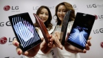Models pose with LG Electronics' G Flex 2 smartphones during a media event at its head office in Seoul, South Korea, Thursday, Jan. 22, 2015. (AP / Ahn Young-joon)