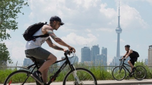 Cyclists ride in Toronto on Wednesday, June 26, 2012.(Frank Gunn / THE CANADIAN PRESS)