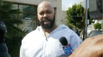 """In this Feb. 26, 2003 file photo, rap music mogul Marion """"Suge"""" Knight walks out of the Los Angeles County jail, in Los Angeles. (AP / Damian Dovarganes, File)"""