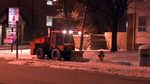 A sidewalk plow operates in Toronto early Friday morning, Jan. 30, 2015.