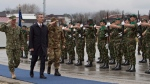 NATO Secretary General Jens Stoltenberg, second left, reviews an honour guard of the NATO-led peacekeeping mission in Pristina, Kosovo, on Jan. 23, 2015. (AP / Visar Kryeziu)