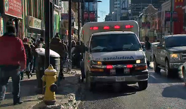 Police are looking for a male suspect after a woman was found with stab wounds in downtown Toronto Friday afternoon.