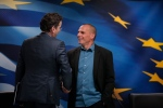 Dutch Finance Minister and Eurogroup President Jeroen Dijsselbloem, left, talks to Greece's Finance Minister Yanis Varoufakis, right, as he leaves following a joint news conference following their meeting at the Finance Ministry in Athens, Friday, Jan. 30, 2015. (AP/Lefteris Pitarakis)