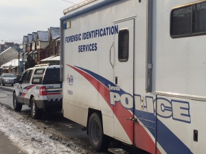 A forensic identification services vehicle is pictured at the scene of a fatal double shooting at Alexandra Park near Bathurst and Dundas streets Saturday January 31, 2015. (Arda Zakarian/CP24)